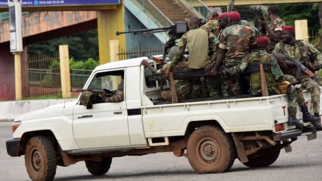 Soldiers of the Guinean Armed Forces head to Time Island in the capital, Conakry